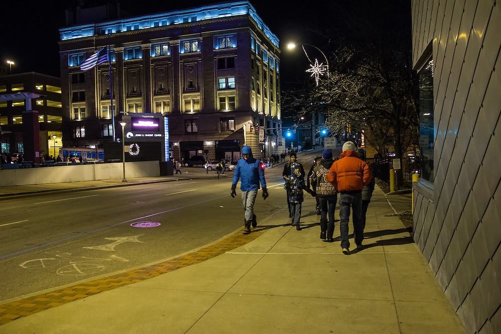 Guest walking between venues at First Night Akron 2015