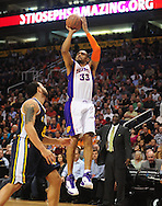 Feb. 15, 2011; Phoenix, AZ, USA; Phoenix Suns forward Grant Hill (33) puts up a basket against the Utah Jazz guard Deron Williams (8) at the US Airways Center. Mandatory Credit: Jennifer Stewart-US PRESSWIRE