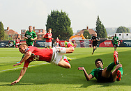 Miguel &Aacute;ngel Llera (right) of Scunthorpe United brings down Joe Bryan (left) of Bristol City during the Sky Bet League 1 match at Ashton Gate, Bristol<br /> Picture by Tom Smith/Focus Images Ltd 07545141164<br /> 06/09/2014