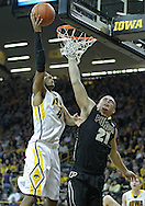 December 28, 2011: Iowa Hawkeyes guard/forward Roy Devyn Marble (4) puts up a shot over Purdue Boilermakers guard/forward D.J. Byrd (21) during the NCAA basketball game between the Purdue Boilermakers and the Iowa Hawkeyes at Carver-Hawkeye Arena in Iowa City, Iowa on Wednesday, December 28, 2011. Purdue defeated Iowa 79-76.