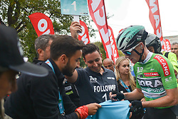 October 14, 2018 - Istanbul, Turkey - Sam Bennett of Ireland and Bora Hansgrohe signs autographs to his fans after he wins the sixth stage - the Salcano Stage 166.7km from Bursa to Istanbul, of the 54th Presidential Cycling Tour of Turkey 2018. .On Sunday, October 14, 2018, in Istanbul, Turkey..Photo by Artur Widak/SIPA USA  (Credit Image: © Artur Widak/NurPhoto via ZUMA Press)