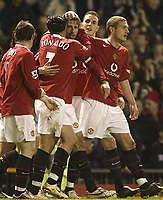 Photo: Aidan Ellis.<br /> Manchester United v West Ham United. The Barclays Premiership. 29/03/2006.<br /> Manchester's ruud Van Nistelrooy is congratulated by team mates after scoring the first goal