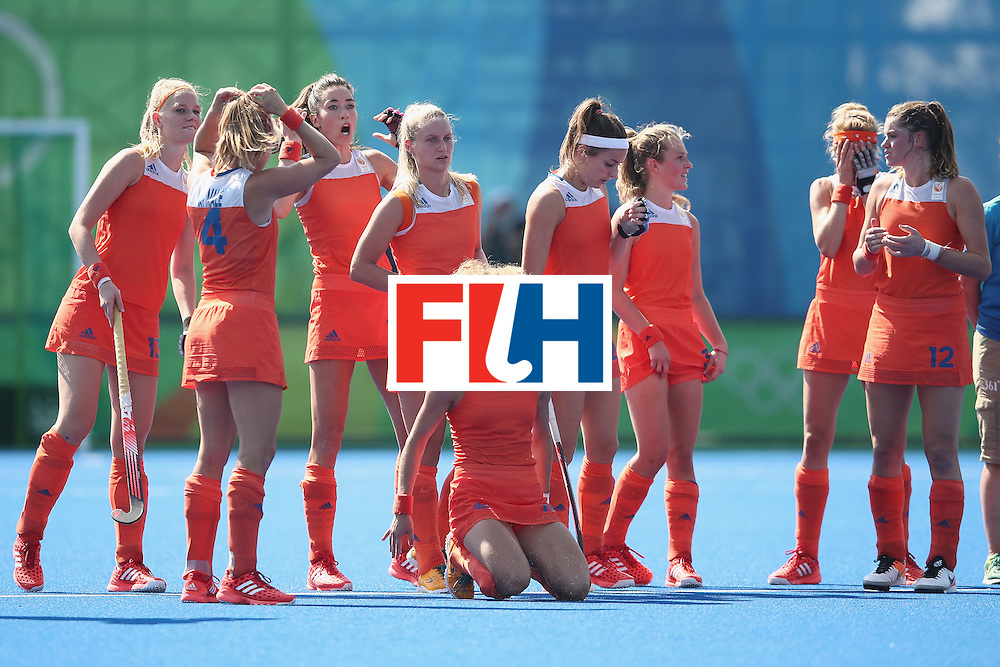 RIO DE JANEIRO, BRAZIL - AUGUST 17:  The Netherlands team react during the penalty shootout during the womens semifinal match between the Netherlands and Germany on Day 12 of the Rio 2016 Olympic Games at the Olympic Hockey Centre on August 17, 2016 in Rio de Janeiro, Brazil.  (Photo by Mark Kolbe/Getty Images)