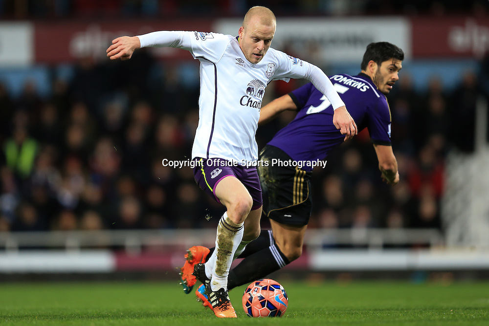 13 January 2015 - The FA Cup 3rd Round (Replay)  - West Ham v Everton - Steven Naismith of Everton in action with James Tomkins of West Ham - Photo: Marc Atkins / Offside.