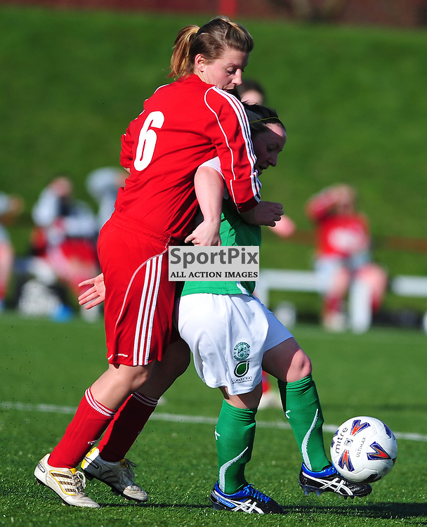 Finella Annand (Inverness, red) gets to grips with Kirsty Mclaughlin..Hibernian v Inverness City, Scottish Women's Premier League, 18 March 2012