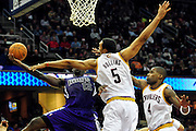 Oct. 30, 2010; Cleveland, OH, USA; Sacramento Kings point guard Tyreke Evans (13) tries to shoot over Cleveland Cavaliers center Ryan Hollins (5) and power forward Antawn Jamison (4) during the third quarter against the \ at Quicken Loans Arena. The Kings beat the Cavaliers 107-104. Mandatory Credit: Jason Miller-US PRESSWIRE