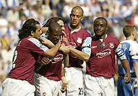 Photo: Aidan Ellis.<br /> Wigan Athletic v West Ham United. The Barclays Premiership. 28/04/2007.<br /> West Ha, goal scorer Louis Boa Morte is mobbed after scoring the first goal