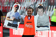 Matt Jay (17) of Exeter City hods up two of the cardboard faces in the crowd at full time as he celebrates  the 3-2 aggregate win during the EFL Sky Bet League 2 Play Off Leg 2 of 2 match between Exeter City and Colchester United at St James' Park, Exeter, England on 22 June 2020.