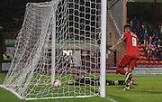 Artur Krysiak looks on as James Berrett's shot deflects past him watched by Vadaine Oliver during the Sky Bet League 2 match between York City and Yeovil Town at Bootham Crescent, York, England on 18 August 2015. Photo by Simon Davies.