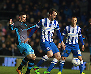Brighton central midfielder Dale Stephens shields the ball from Sheffield Wednesday striker Gary Hooper during the Sky Bet Championship match between Brighton and Hove Albion and Sheffield Wednesday at the American Express Community Stadium, Brighton and Hove, England on 8 March 2016. Photo by Bennett Dean.