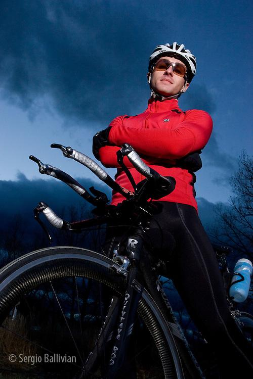 A triathlete trains on his aerodynamic bike for the upcoming Ironman