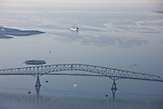 Francis Scott Key Bridge with Carnival cruise ship in background shot from airplane