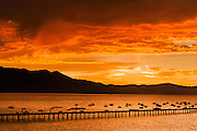 Dramatic sunset over south lake tahoe and the pier and marina at Tahoe Lakeshore Lodge and Spa and Action Sports pier
