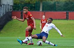 KIRKBY, ENGLAND - Saturday, August 10, 2019: Liverpool's Elijah Dixon-Bonner is tackled by Tottenham Hotspur's captain TJ Eyoma during the Under-23 FA Premier League 2 Division 1 match between Liverpool FC and Tottenham Hotspur FC at the Academy. (Pic by David Rawcliffe/Propaganda)