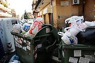 Roma   Giugno  2010.Cassonetti della spazzatura pieni e rifiuti per la strada,al quartiere Fidene