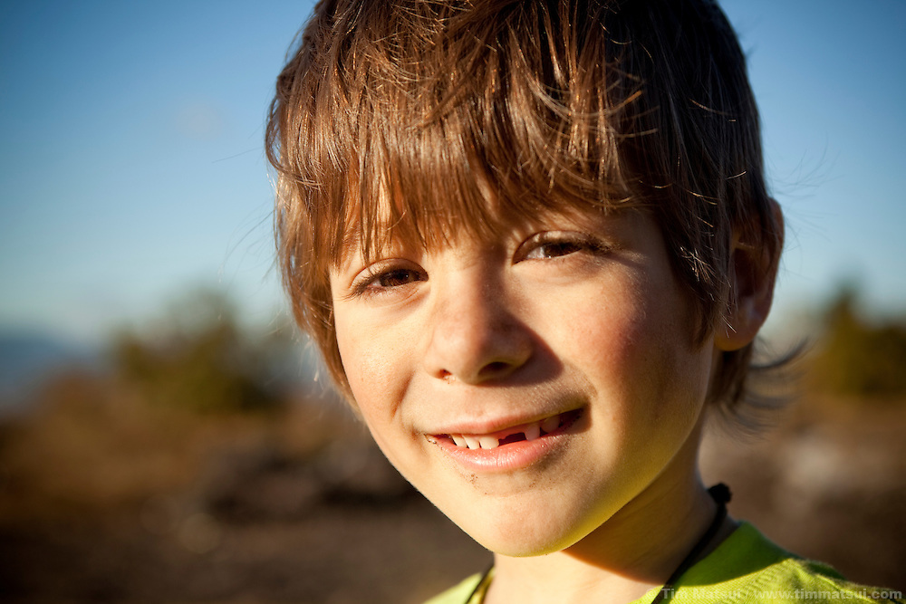A young caucasian boy smiles with dirt on his face from playing.<br /> <br /> Image available from Getty Images using Master ID: 103427949<br /> <br /> Or by copying this link:<br /> http://bit.ly/gfFwNY