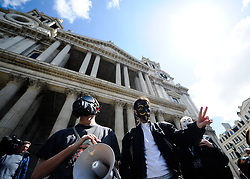 © Licensed to London News Pictures. 12/05/2012. London, Britain.  Occupy London protesters wearing a mask is posing in front of St. Paul's Cathedral. Photo credit : Thomas Campean/LNP