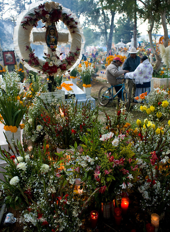 People celebrating Day of the Dead from dusk to dawn in the town of TzinTzunTzan, Mexico.