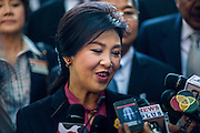 "09 JANUARY 2105 - BANGKOK, THAILAND: YINGLUCK SHINAWATRA, former Prime Minister of Thailand, talks to reporters after presenting her defense during her impeachment at the National Legislative Assembly. Thailand's military-appointed National Legislative Assembly began impeachment hearings Friday against former Prime Minister Yingluck Shinawatra. If she is convicted, she could be forced to stay out of politics for five years. During her defense, Yingluck questioned the necessity of her impeachment, saying, ""I was removed from office, the equivalent of being impeached, three times already, I have no position left to be impeached from."" A decision on her impeachment is expected by the end of January.    PHOTO BY JACK KURTZ"