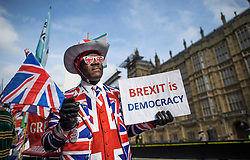 © Licensed to London News Pictures. 31/10/2019. London, UK. A Pro Brexit supporter outside the Houses of Parliament Westminster, London on October 31st, 2019, the day the UK was due to Leave the EU, before an extension was granted.. A general election will be held on December 12th.  Photo credit: Ben Cawthra/LNP