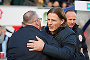 Peterborough United manager Steve Evans greets Wycombe Wanderers manager Gareth Ainsworth before the EFL Sky Bet League 1 match between Wycombe Wanderers and Peterborough United at Adams Park, High Wycombe, England on 3 November 2018.