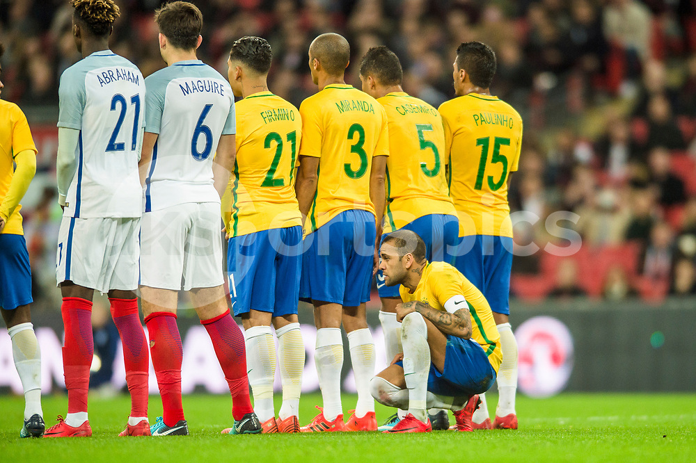 Dani Alves of Brazil assess the view through the defensive wall during the international friendly match between England and Brazil at Wembley Stadium, London, England on 14 November 2017. Photo by Darren Musgrove.