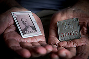 Pete Marovich, Sr., holds his father's Jones and Laughlin Steel Company ID card and badge on June 7, 2015 near Aliquippa, Pennsylvania, USA. An immigrant from Yugoslavia as a teenager, Tom Marovich worked in the J&L mill for 37 years. The company cut the ID card in half upon his retirement.