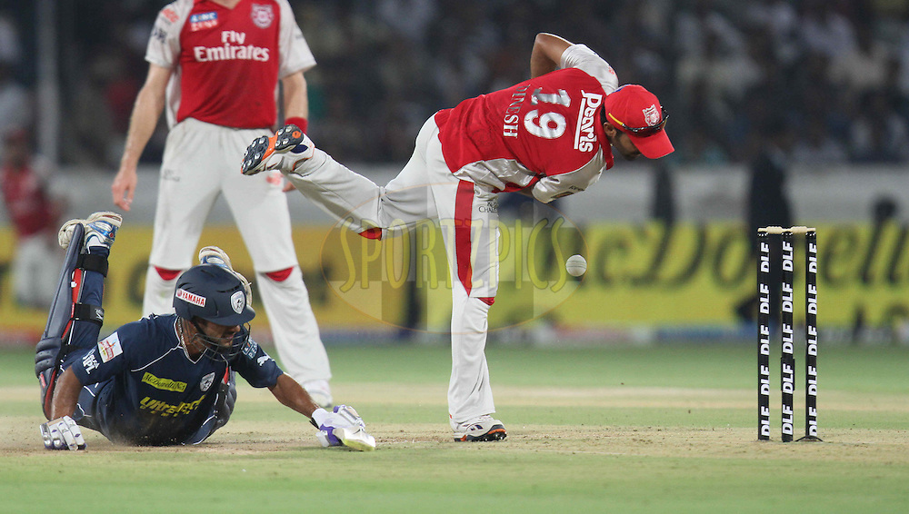 Shikhar Dhawan (L) of Deccan Chargers dives during match 15 of the Indian Premier League ( IPL ) between the Deccan Chargers and the Kings XI Punjab held at the Rajiv Gandhi International Cricket Stadium in Hyderabad on the 16th April 2011. Photo by Parth Sanyal/BCCI/SPORTZPICS
