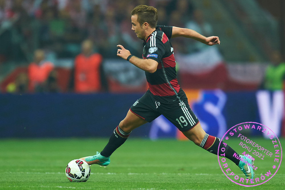 German's Mario Gotze controls the ball during the EURO 2016 qualifying match between Poland and Germany on October 11, 2014 at the National stadium in Warsaw, Poland<br /> <br /> Picture also available in RAW (NEF) or TIFF format on special request.<br /> <br /> For editorial use only. Any commercial or promotional use requires permission.<br /> <br /> Mandatory credit:<br /> Photo by &copy; Adam Nurkiewicz / Mediasport