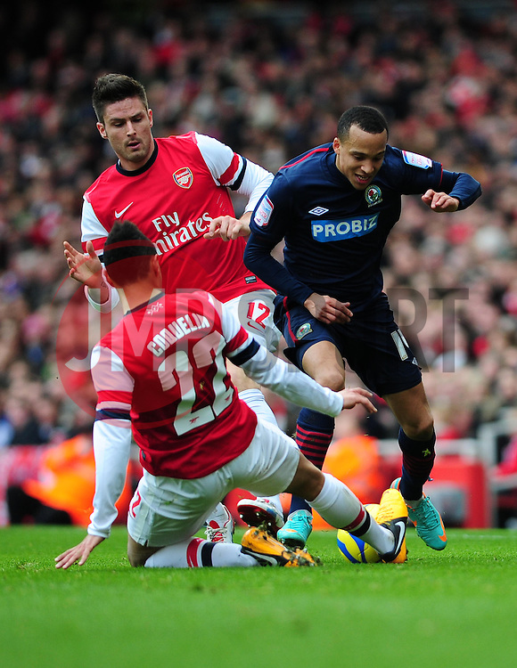 Arsenal's Francis Coquelin challenges Blackburn Rovers' Marcus Olsson - Photo mandatory by-line: Dougie Allward/JMP - Tel: Mobile: 07966 386802 16/02/2013 - SPORT - FOOTBALL - Emirates Stadium - London -  Arsenal V Blackburn Rovers - FA Cup - Fifth Round