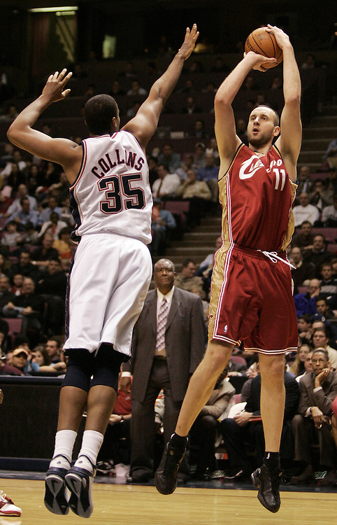 Cleveland Cavaliers Zydrunas Llgauskas shoots a jump shot over  New Jersey Nets Jason Collins at the Continental Airlines Arena. East Rutherford, New Jersey Wednesday  22 December 2004.