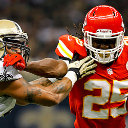 September 23, 2012; New Orleans, LA, USA; Kansas City Chiefs running back Jamaal Charles (25) stiff arms New Orleans Saints linebacker Jonathan Casillas (52) on a run during the first quarter of a game at the Mercedes-Benz Superdome. Mandatory Credit: Derick E. Hingle-USA TODAY SPORTS