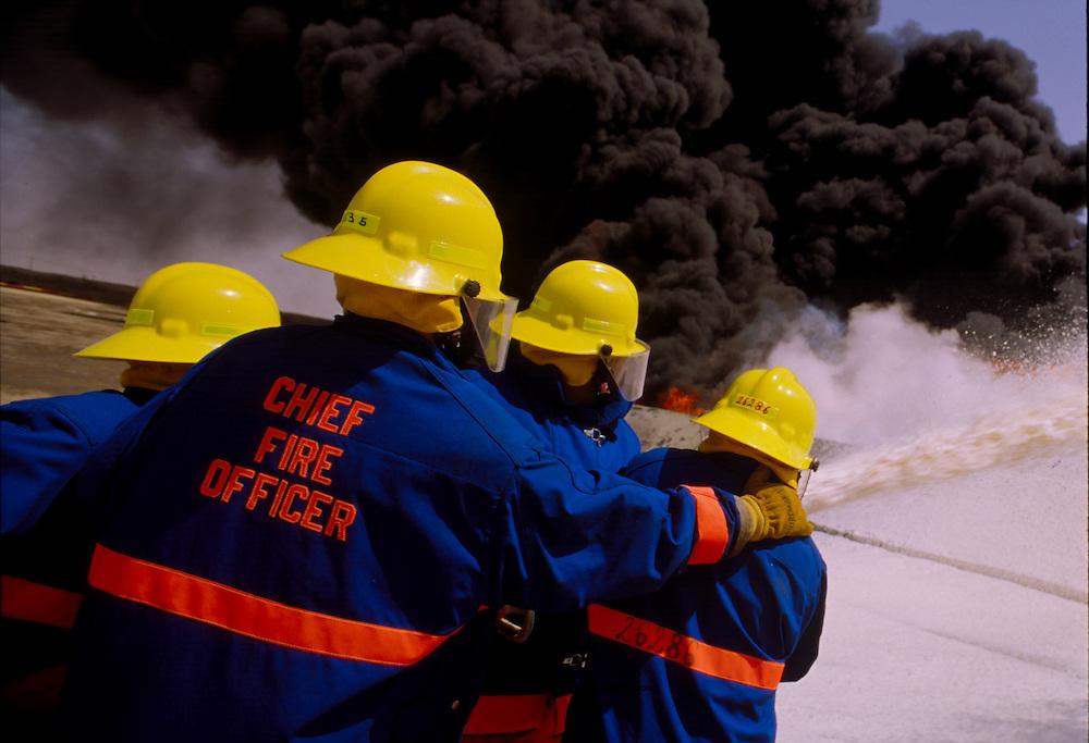 Fire training at oil refinery, Wafra oil field, Kuwait.