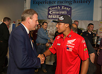 Governor Chris Sununu with flat track racer Cameron Smith during the 2019 kickoff of Laconia's 96th Motorcycle Week at North East Motor Sports Museum in Loudon Thursday morning.  (Karen Bobotas/for the Laconia Daily Sun)