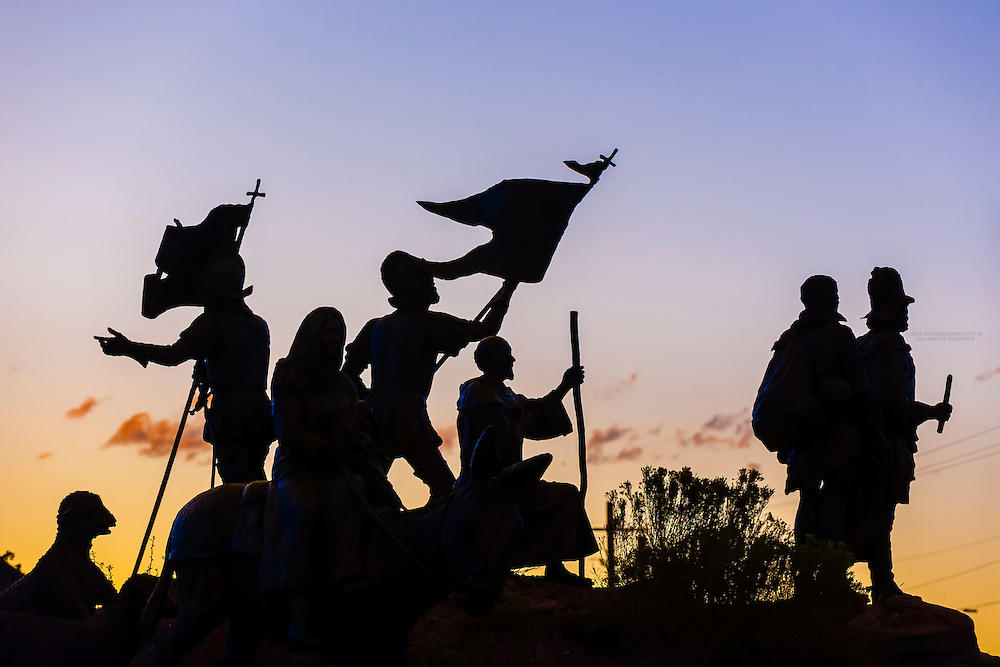 "Silhouette of ""Cuarto Centenario"" sculpture, Albuquerque Museum, Albuquerque, New Mexico USA. Four hundred years ago, in April of 1598, Spanish explorer Juan de Oñate and 500 colonists from Mexico crossed the Rio Grande to claim the new land for the King of Spain."