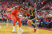 LUBBOCK, TX - JANUARY 13: Daxter Miles Jr. #4 of the West Virginia Mountaineers goes to the basket against Norense Odiase #32 of the Texas Tech Red Raiders during the game on January 13, 2018 at United Supermarket Arena in Lubbock, Texas. Texas Tech defeated West Virginia 72-71. (Photo by John Weast/Getty Images) *** Local Caption *** Daxter Miles Jr.;Norense Odiase