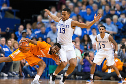 Tennessee guard Kevin Punter, left, loses control of his dribble with pressure from Kentucky guard Isaiah Briscoe in the second half.<br /> <br /> The University of Kentucky hosted the University of Florida, Thursday, Feb. 18, 2016 at Rupp Arena in Lexington .