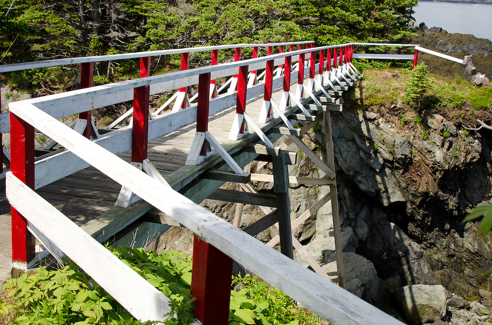 A pedestrian bridge spans one of the deeper inlets between the parking area and the Head Harbor Light, Campobello Island.