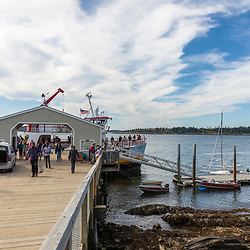 Passengers disembark a Maine State Ferry at the dock on Cliff Island in Casco Bay, Portland, Maine.