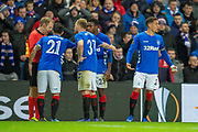 Daniel Candeias (#21) of Rangers FC, Lassana Coulibaly (#23) of Rangers FC, Scott Arfield (#37) of Rangers FC and James Tavernier (#2) of Rangers FC argue with the assistant referee after Candeias is shown a red card during the Europa League group stage match between Rangers FC and Villareal CF at Ibrox, Glasgow, Scotland on 29 November 2018.