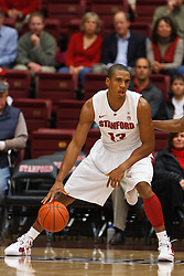 Nov 28, 2011; Stanford CA, USA;  Stanford Cardinal forward/center Josh Owens (13) dribbles the ball against the Pacific Tigers during the first half at Maples Pavilion. Stanford defeated Pacific 79-37. Mandatory Credit: Jason O. Watson-US PRESSWIRE