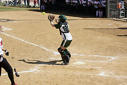 05 April 2008: Kelly Nelson gets a throw for a play at the plate well before the runner approaches. The Carthage College Lady Reds lost the first game of this double header to the Titans of Illinois Wesleyan 4-1 at Illinois Wesleyan in Bloomington, IL
