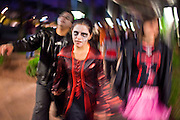 "Oct. 30, 2009 -- PHOENIX, AZ: PRISCILLA MARQUEZ leads a group of Zombies into a shopping area during the Zombie Walk in Phoenix Friday. About 200 people participated in the first ""Zombie Walk"" in Phoenix, AZ, Friday night. The Zombies walked through downtown Phoenix ""attacking"" willing victims and mixing with folks going to the theatre and downtown sports venues.  Photo by Jack Kurtz"