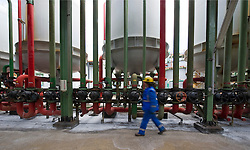 Operator Kurt Steemans, adjusts valves on the chlorine filtration tanks at the Solvay SA chemical plant in Antwerp, Belgium, on Thursday, April 22, 2010. Chlorine is the main product produced at Solvay's Antwerp facility.  Solvay SA is the world's largest supplier of Soda Ash or Sodium Carbonate and is also a major producer of caustic soda, hydrogen peroxide, chlorine and fluorinated products. (Photo © Jock Fistick)