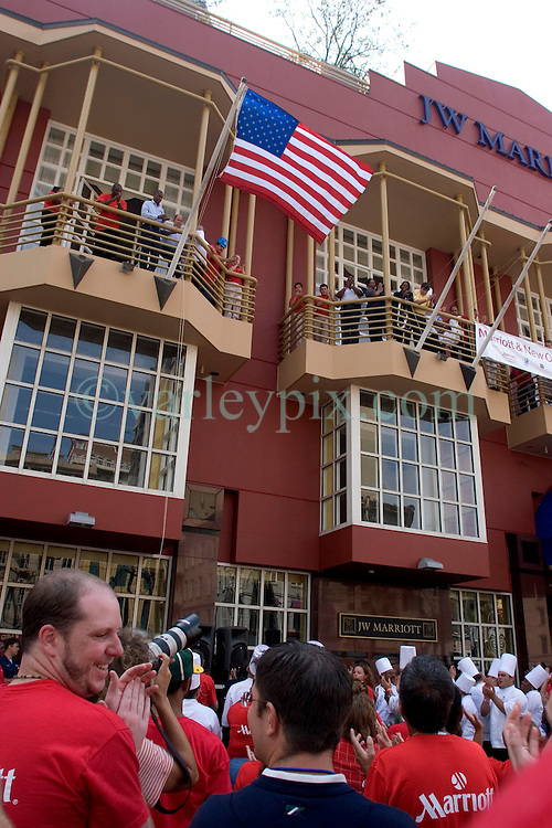 30 Sept, 2005. New Orleans, Louisiana. Hurricane Katrina aftermath. <br /> Staff at the Marriott on Canal Street in the heart of downtown New Orleans applaud the official reopening of the hotel as businesses and their employees return to the city.<br /> Photo; ©Charlie Varley/varleypix.com