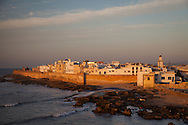 The walled old city of Essaouira, Morocco is bathed in late day light just before sunset.  The city's medina has been named a UNESCO World Heritage site. The city lies on the Atlantic coast of Morocco in northern Africa. http://www.gettyimages.com/detail/photo/essaouira-morocco-with-evening-light-royalty-free-image/182986695