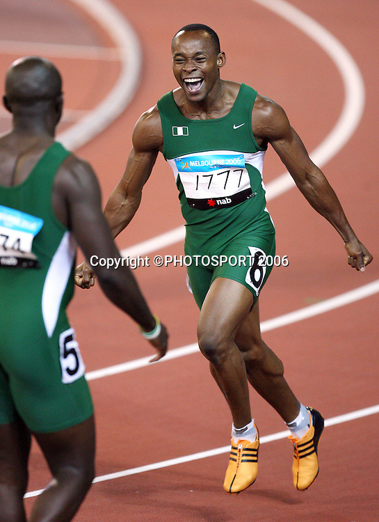 Nigerian athlete Fasuba Soji (NGR) celebrates after achieving a personal best in the Men's 100m final on Day 5 of the XVIII Commonwealth Games at the MCG, Melbourne, Australia on Monday 20 March, 2006. Photo: Hannah Johnston/PHOTOSPORT<br /><br />150701 nigeria celebration celebrating