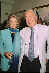 MR & MRS ANDREW SINCLAIR at an exhibition in London on 3rd September 1997.MAY 25