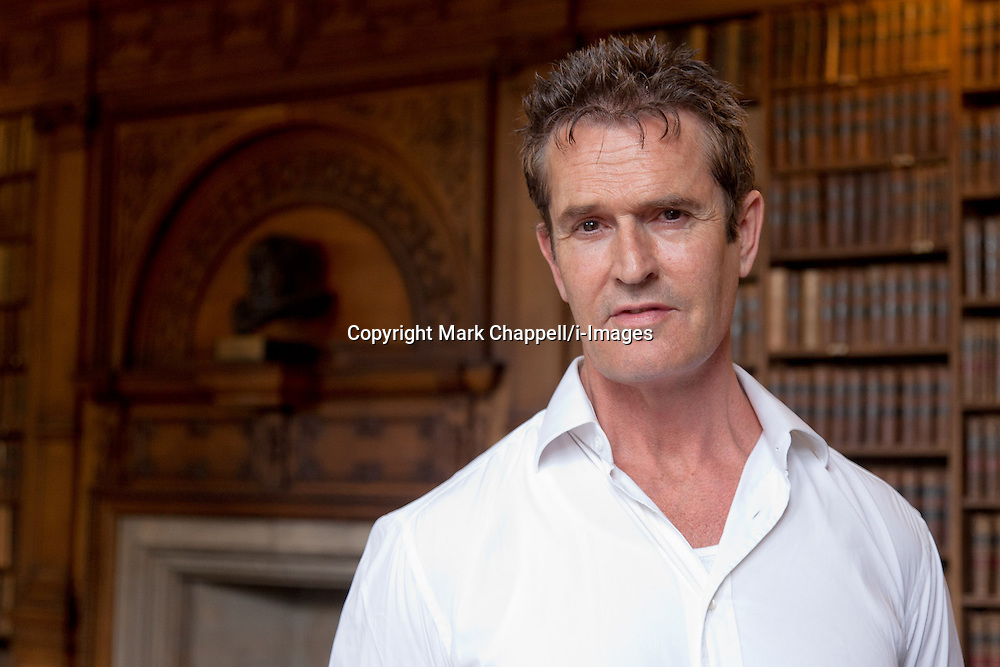 Actor Rupert Everett photographed  in the Old Library of The Oxford Union. He was accompanying Italian fashion designer Donetella Versace who addressed the members of the world renown debating society.OXFORD, UNITED KINGDOM. May 30 2012.<br /> Photo Credit: Mark Chappell/i-Images<br /> &copy; Mark Chappell/i-Images 2012. All Rights Reserved. See instructions