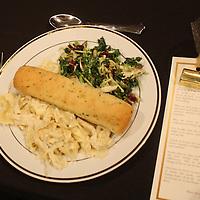 Chicken alfredo, kale salad and breadsticks.